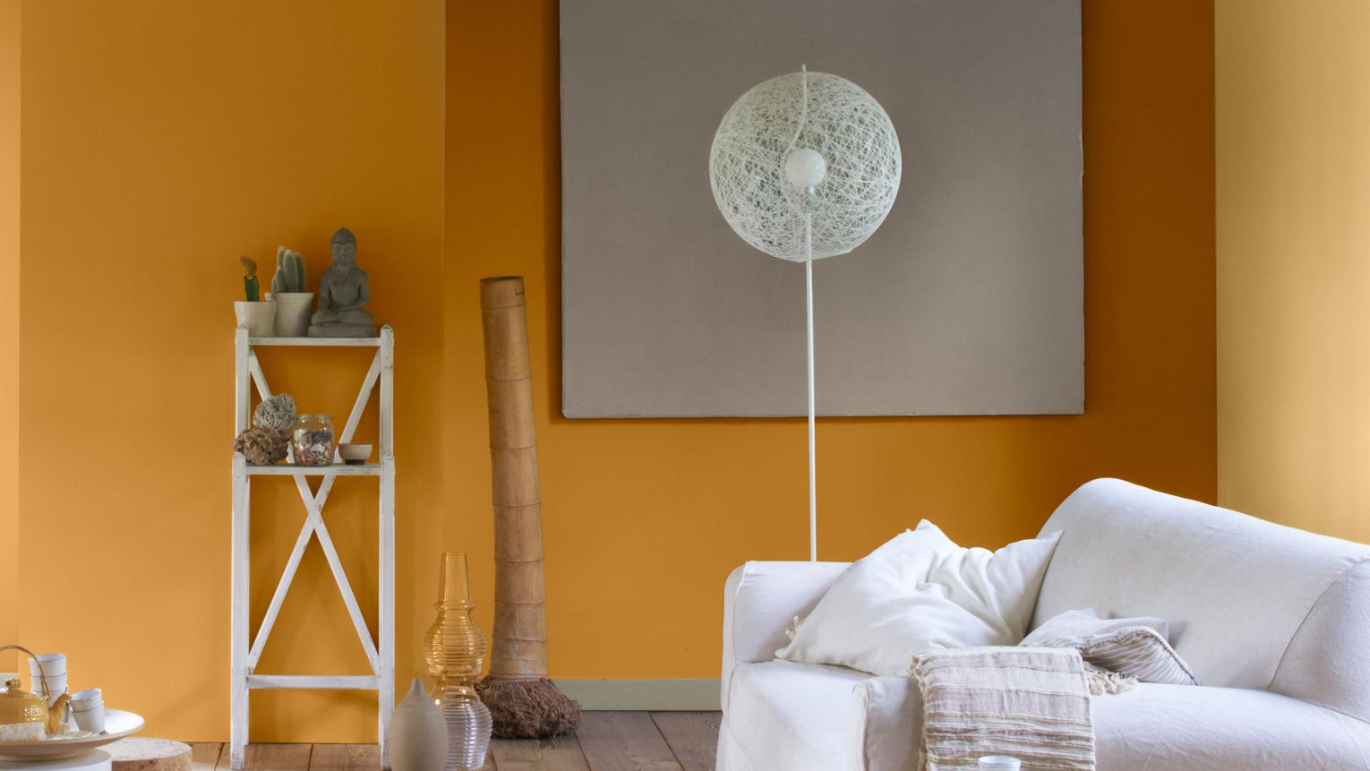 If it's warmth you're after, don't be afraid to use light terracotta or oranges – a sunny hue can brighten and warm a dark, dingy space.