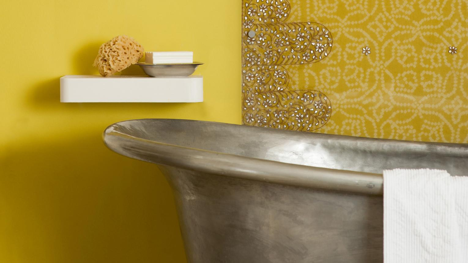 Bright yellow makes a windowless bathroom seem light
