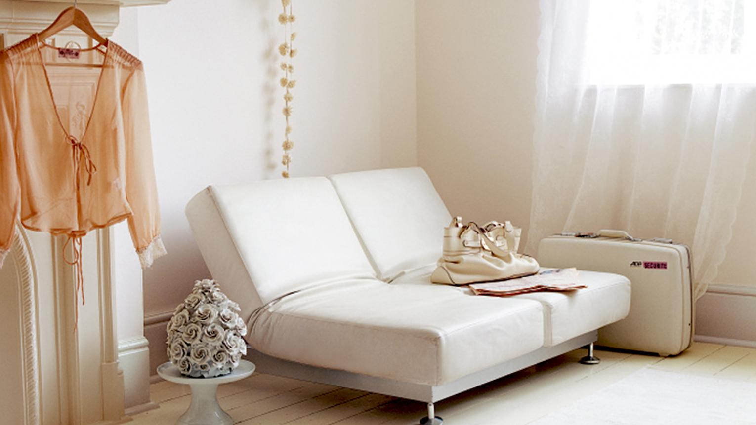 For a living room that's classic yet cosy, pair a white colour scheme with touchable textures to create a layered look.