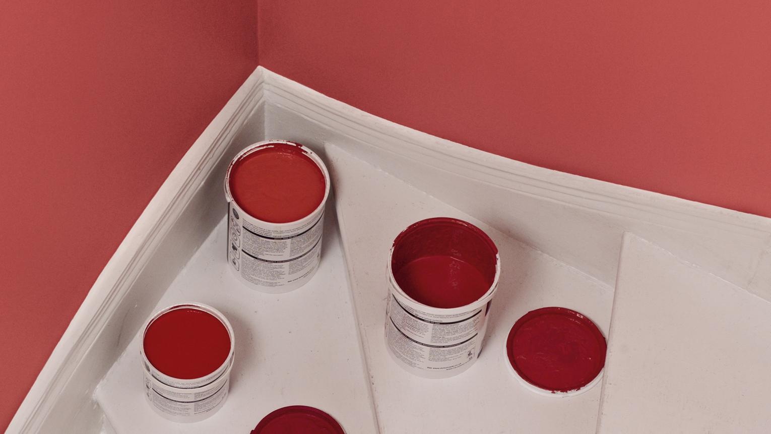 Leftover red paint that needs to be disposed of.