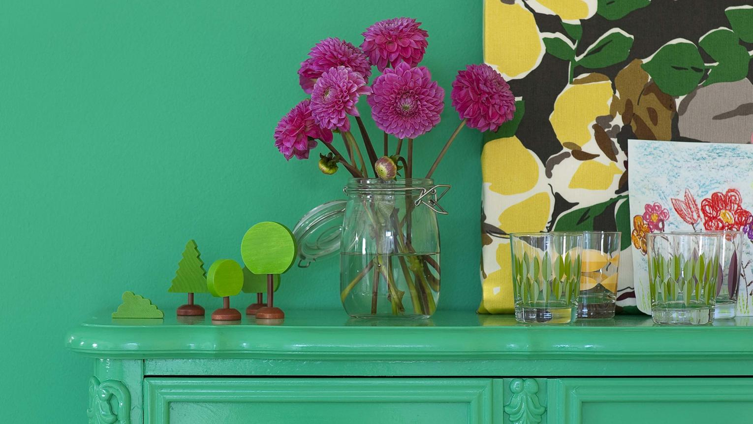 Kitchen cabinets painted in bright green.
