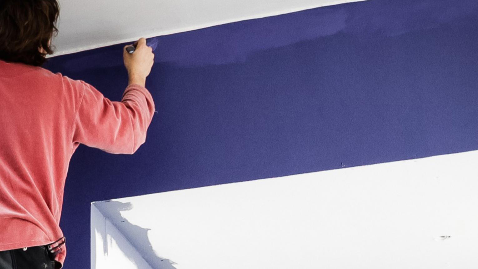 "If you're painting your walls and ceiling two different colours, you'll need to ""cut in"" the corners to achieve a flawless finish."