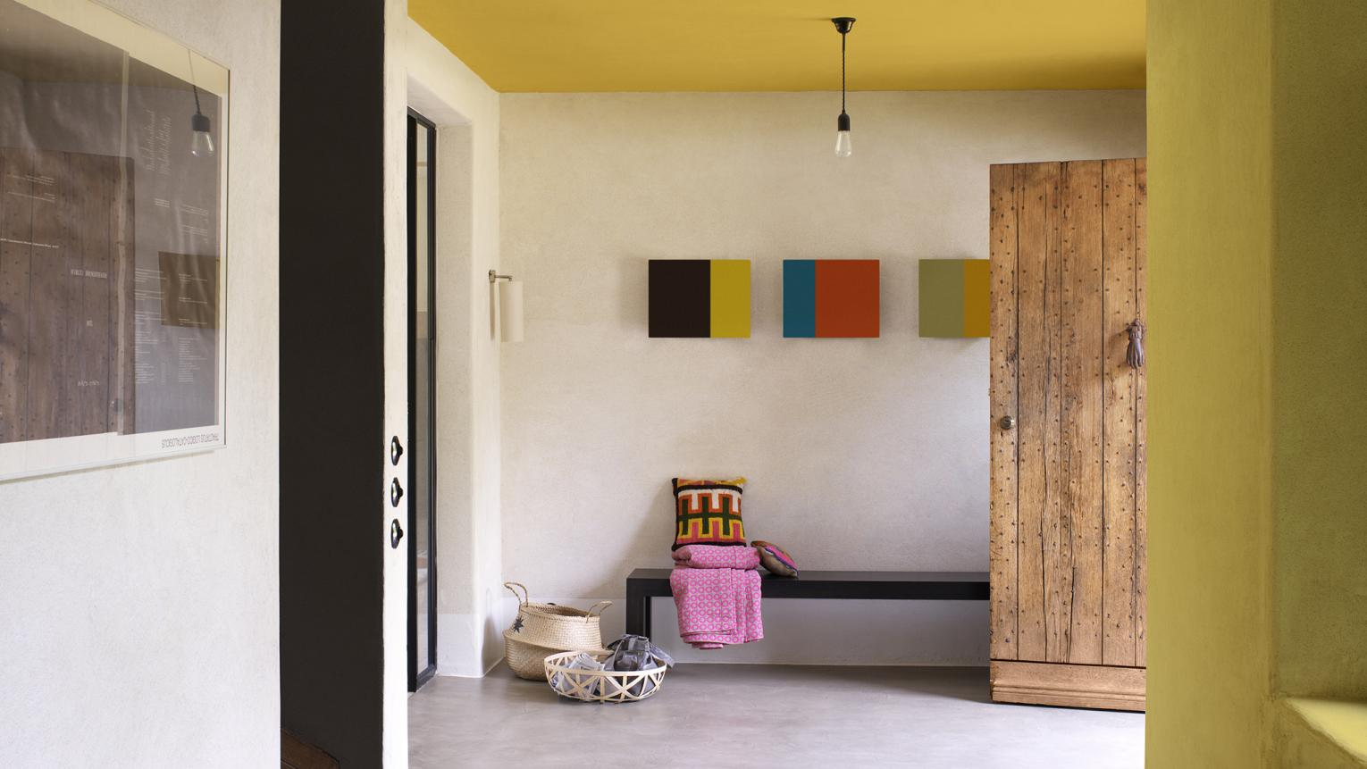 Create a statement hallways by painting your ceiling and one wall a vibrant yellow.