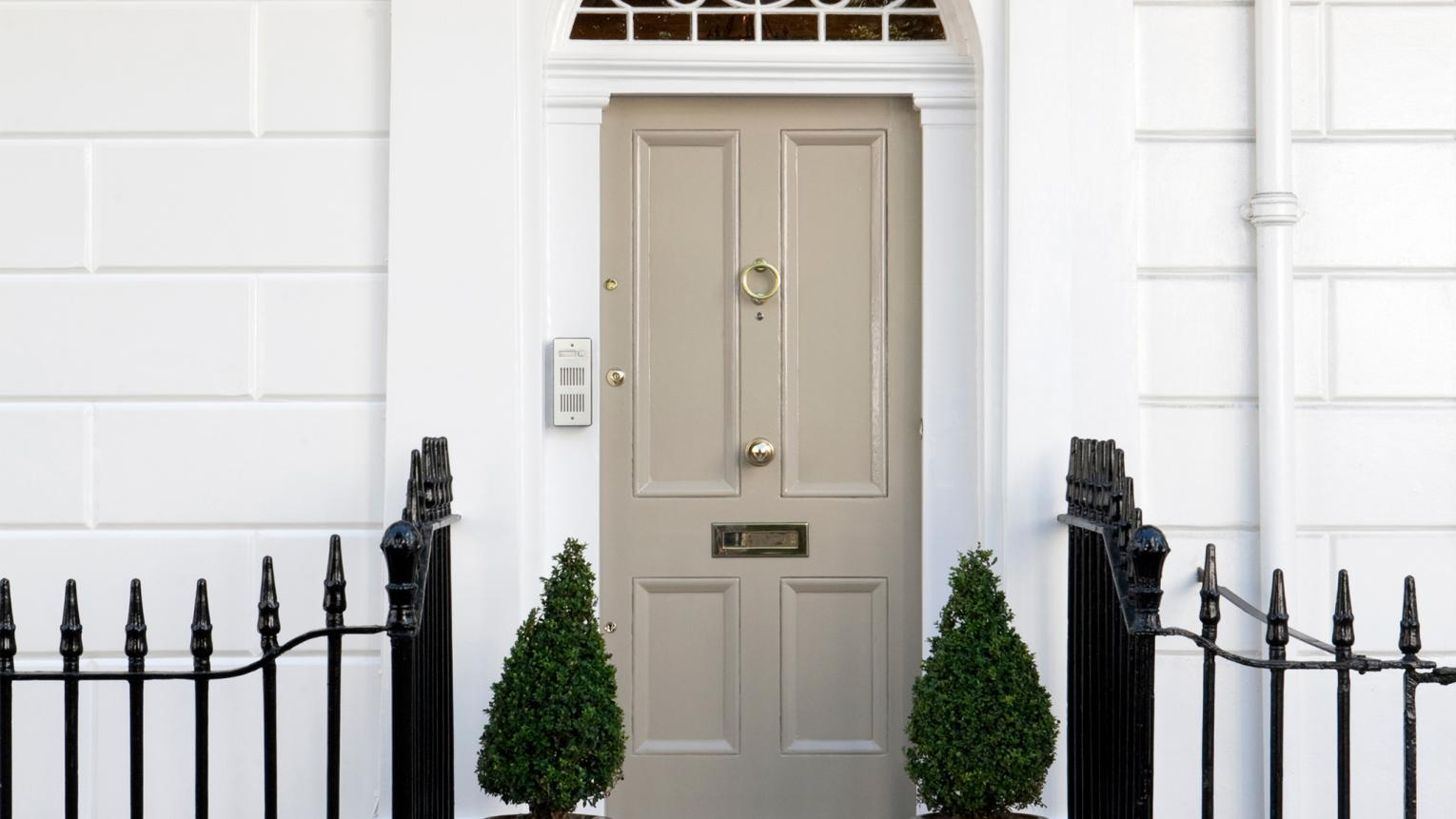 Painting your front door in a classic neutral colour smartens up the exterior of your house.