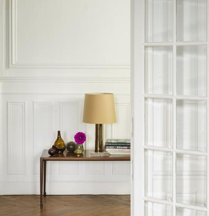 Create an elegant interior that emulates Parisian style by layering different shades of white paint.