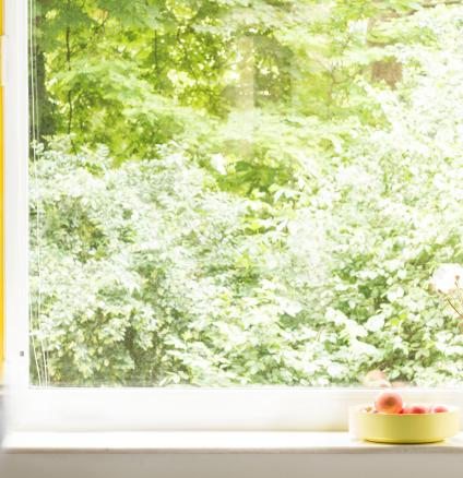 For a quick decorating project, highlight your windows with an eye-catching colour such as bold yellow.