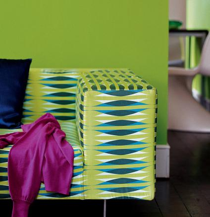 Living room decorated in lively shades of lime, electric blue and fuchsia.